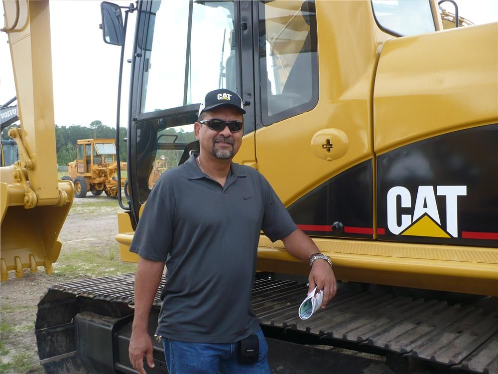 Ernesto Median of Solution Equipment, looks for a Cat 320 to send to Venezuela.
