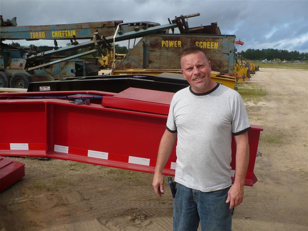 Joseph Griffin of A&J Salvage of Forester, R.I., looks at several of the Challenger trailers.