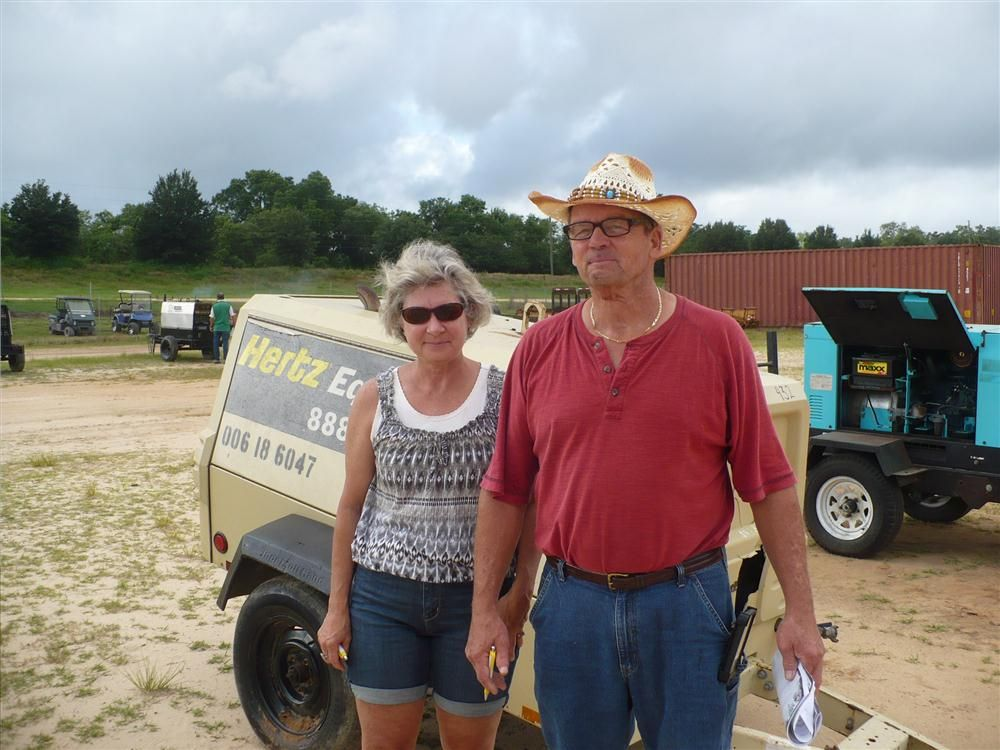 Donna and Neil Bailey shop the wide variety of equipment.