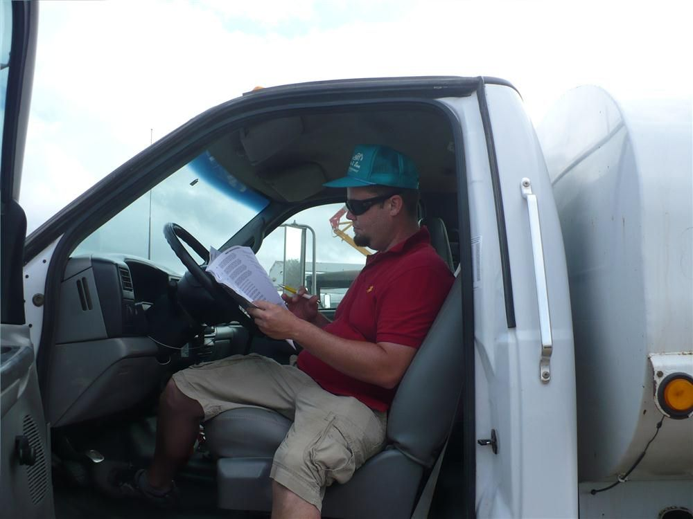 Robert Vigon of NRJ Import & Export in Miami, Fla., checks out this water truck.