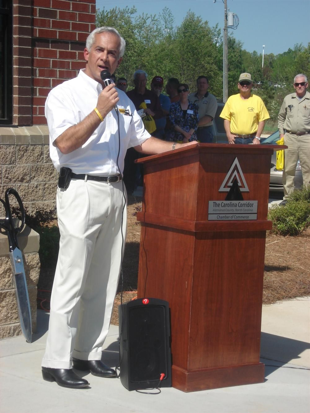 Greg Poole III, chairman and president of Gregory Poole Equipment Company, addressed 300 guests at the Mebane, N.C., facility's grand opening in 2009.