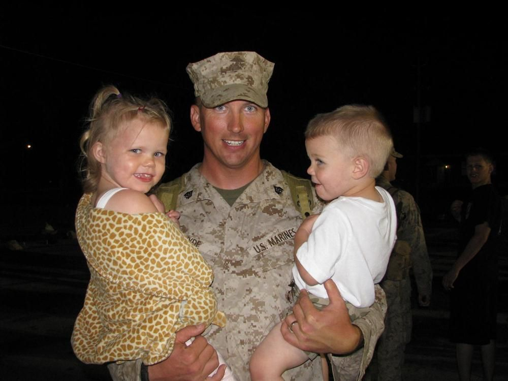 Sgt. Hyde and his children smile for the camera.