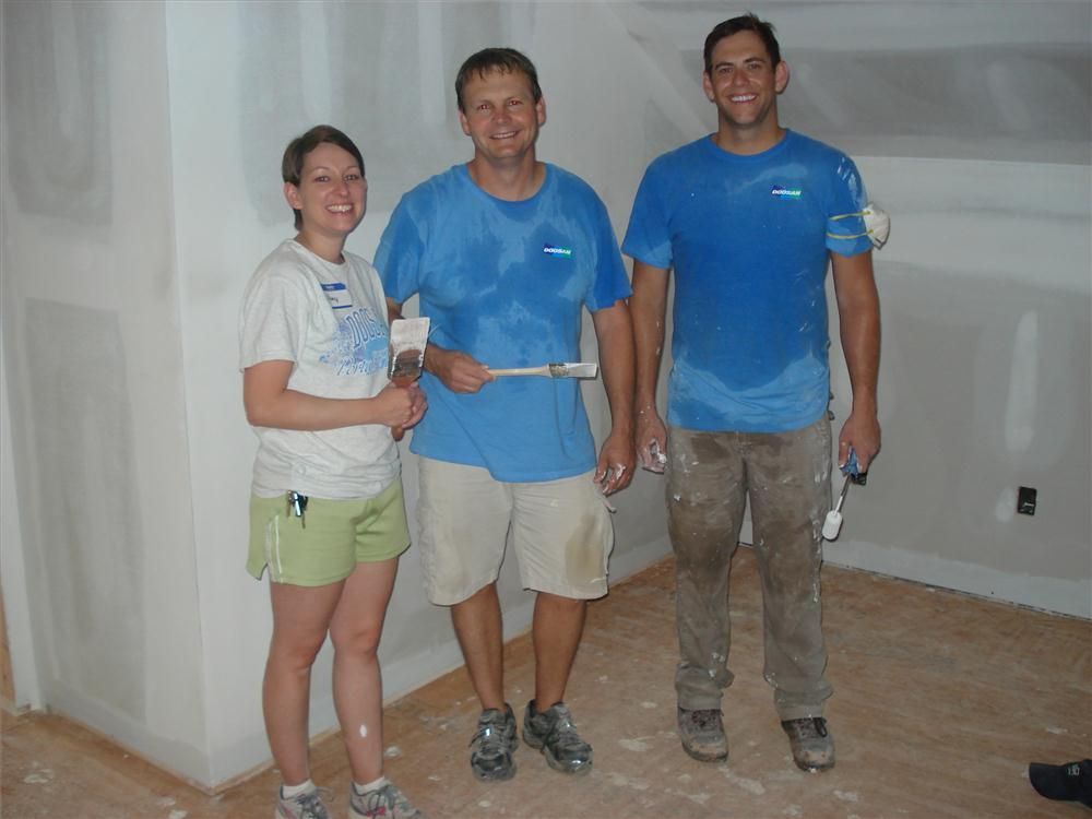 (L-R): Amy Meadows, Rus Warner and Wyatt Franks all of Doosan Portable Power volunteer their time at the 555 Charity home jobsite.