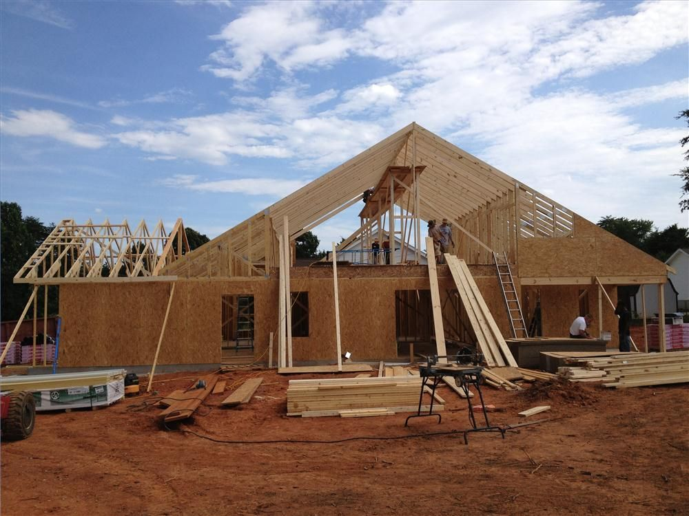Volunteers add the trusses to the first of five homes built by 555 Charity.