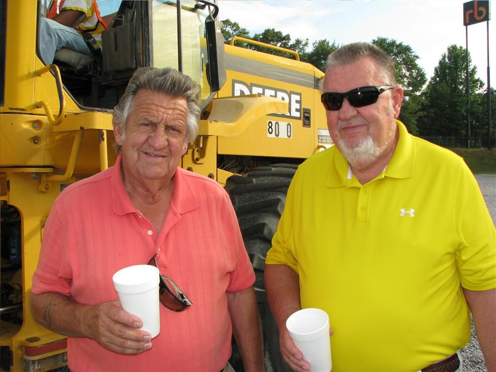 Johnny Dowey (L) and Charles Dowey, both of Carolina Wrecking, Columbia, S.C., enjoy their morning coffee before the sale.