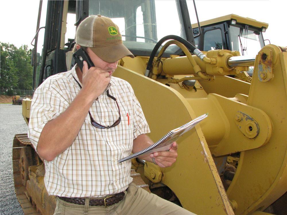 Zach Klinger of Earthworm Outdoors, Atlanta, Ga., calls for more information on a crawler loader.