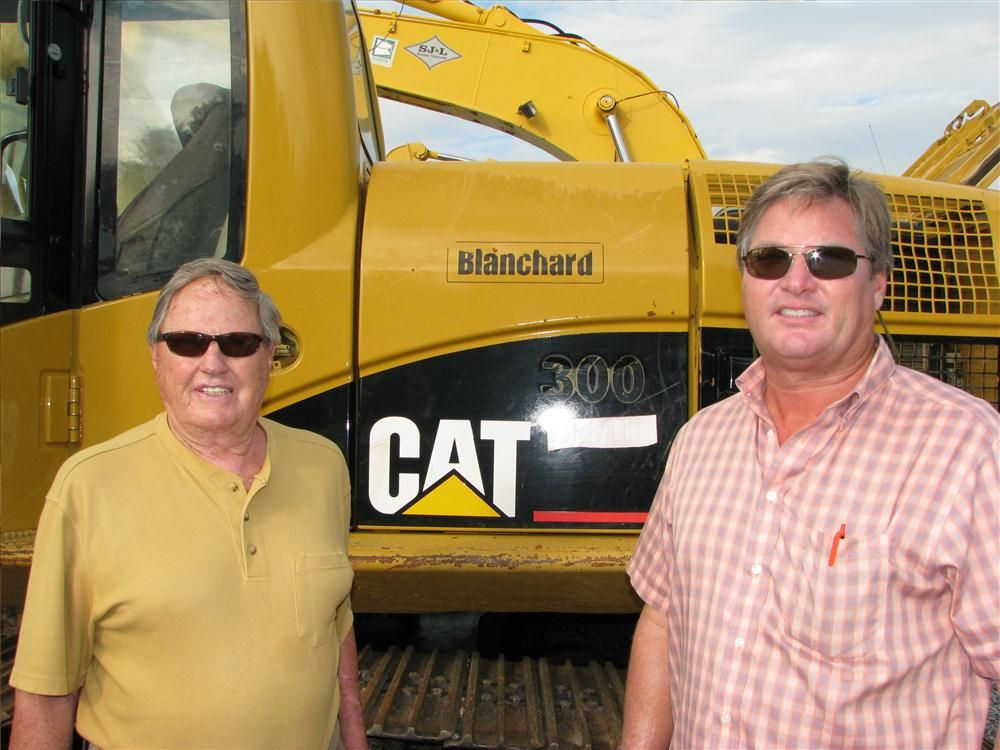B. Brown (L) and his son Brett Brown of Browns Construction Company, Chattanooga, Tenn., shop for bargains on excavators.