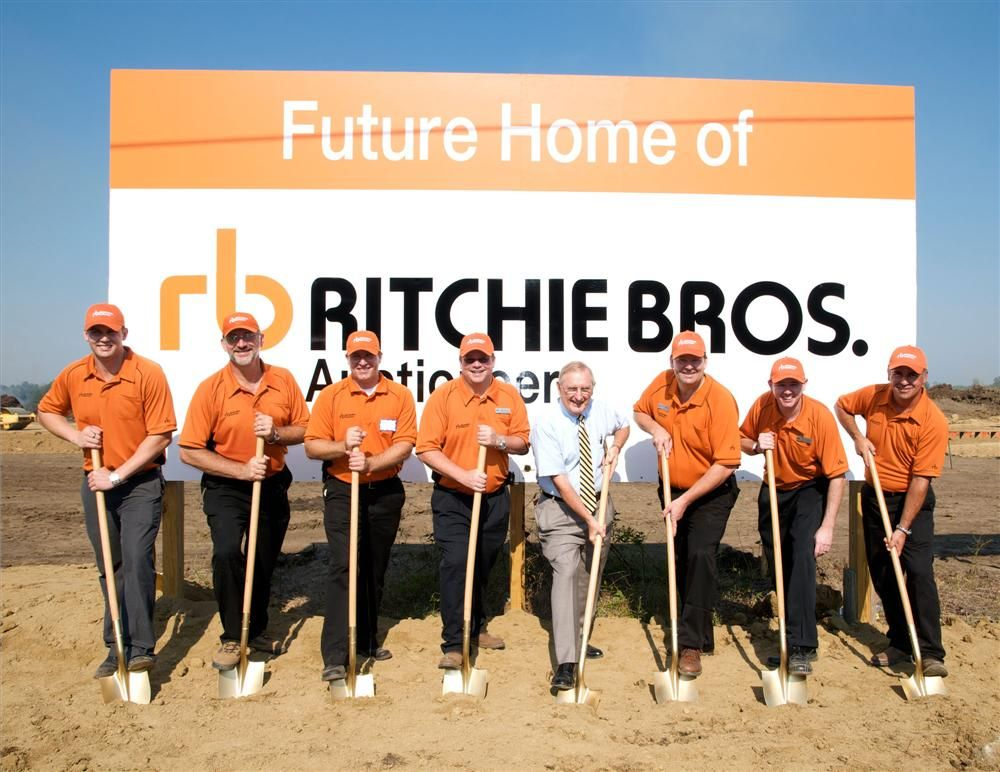 At the groundbreaking (L-R) are Ben Swanson (real estate coordinator), Tim Kander (Ritchie Bros. construction project manager), Patrick Cunningham (Ritchie Bros. yard manager), John Fairley (Ritchie Bros. area manager), Mayor Tom Lane (of the city of Butn