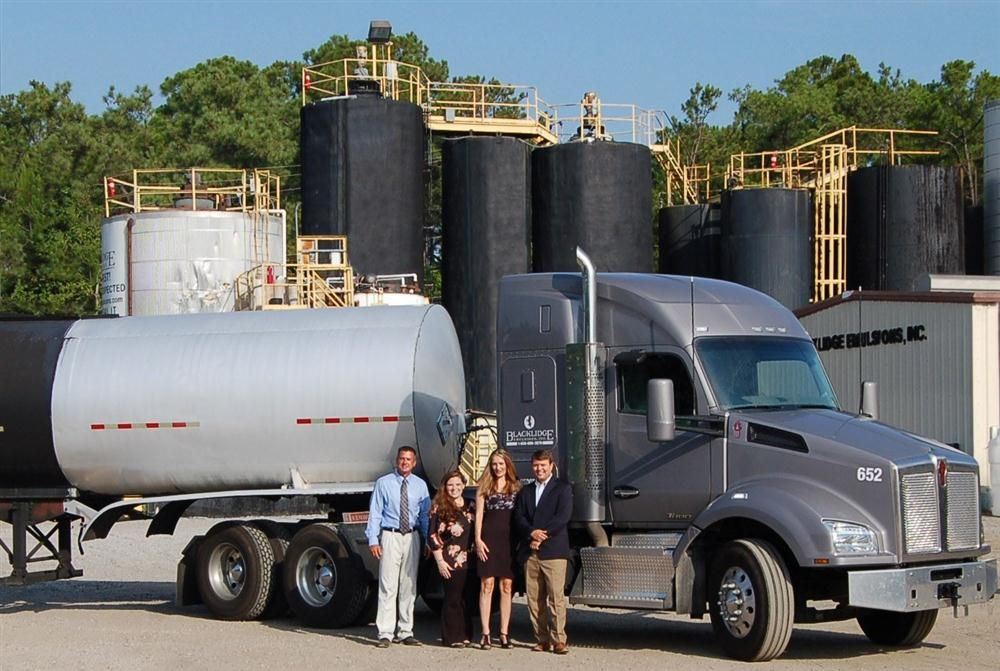 The Kenworth T880 is making a visual impression on Blacklidge Emulsion's customers. (L-R) are Paul Johnson; Melanie Reilly — dispatch; Megan Schmitt — dispatch; and Brittany Blacklidge — president.