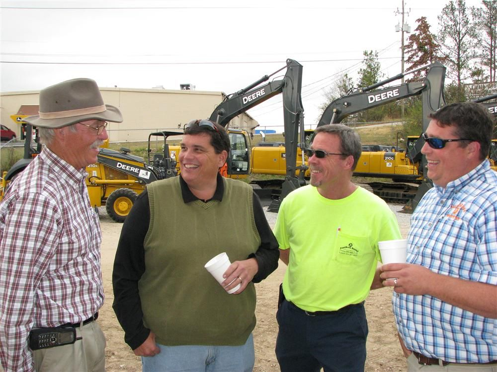 (L-R): Cleve Deason, Warrior sales representative, talks to some of his rental company customers, including Rusty Gentry, David Hamm and Byron Gentry, JustRuss Rental & Equipment, Calera and Auburn, Ala.