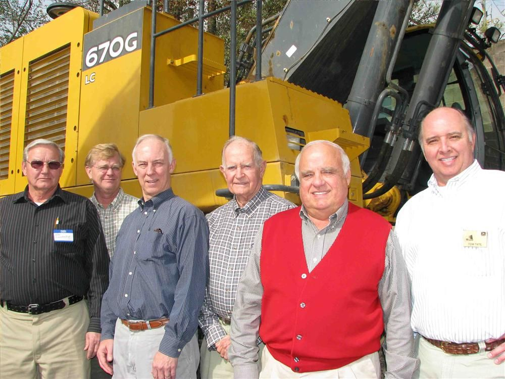 Discussing a Deere 670G excavator are (L-R) Ken Dunaway, Robin Wade III, Charlie Spencer and Robin Wade Jr. of Wade Sand & Gravel Co., Birmingham, Ala.; Gene Taylor and Tom Tate of Warrior Tractor.
