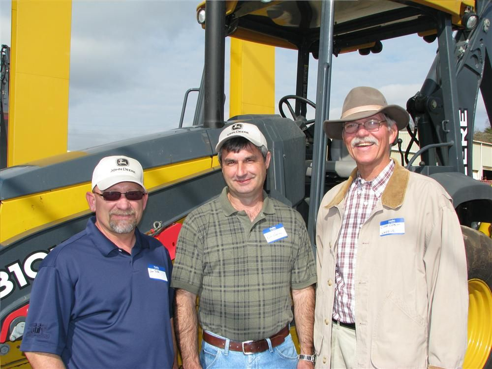 (L-R): Van Folds and Kurt Kenney, Utility Lines Construction, a division of Asplundh, Birmingham, Ala.; and their Warrior Tractor salesman Cleve Deason with their newest machine purchase, a Deere 310K backhoe loader, which just made it to the Warrior Trac