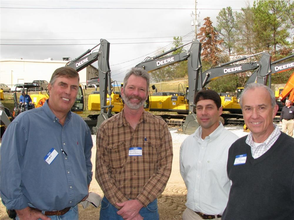 (L-R): Duane Gilkey and Russell Morrow, Morrow Railroad Builders, Birmingham, Ala; Mike Sims and David Pearson, Warrior Tractor, discuss the equipment on display.