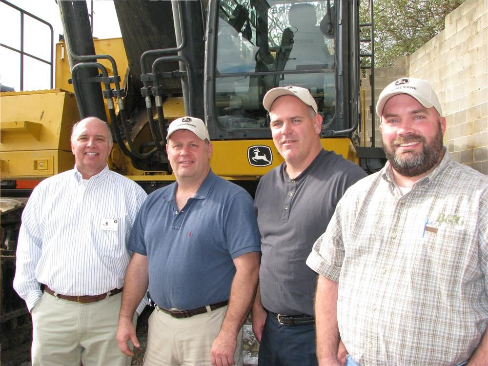 (L-R): Tom Tate, Warrior Tractor, talks with customers interested in some big iron; David Kirkland, Keith Barton and Justin Taylor, Brasfield  & Gorrie, Birmingham, Ala.