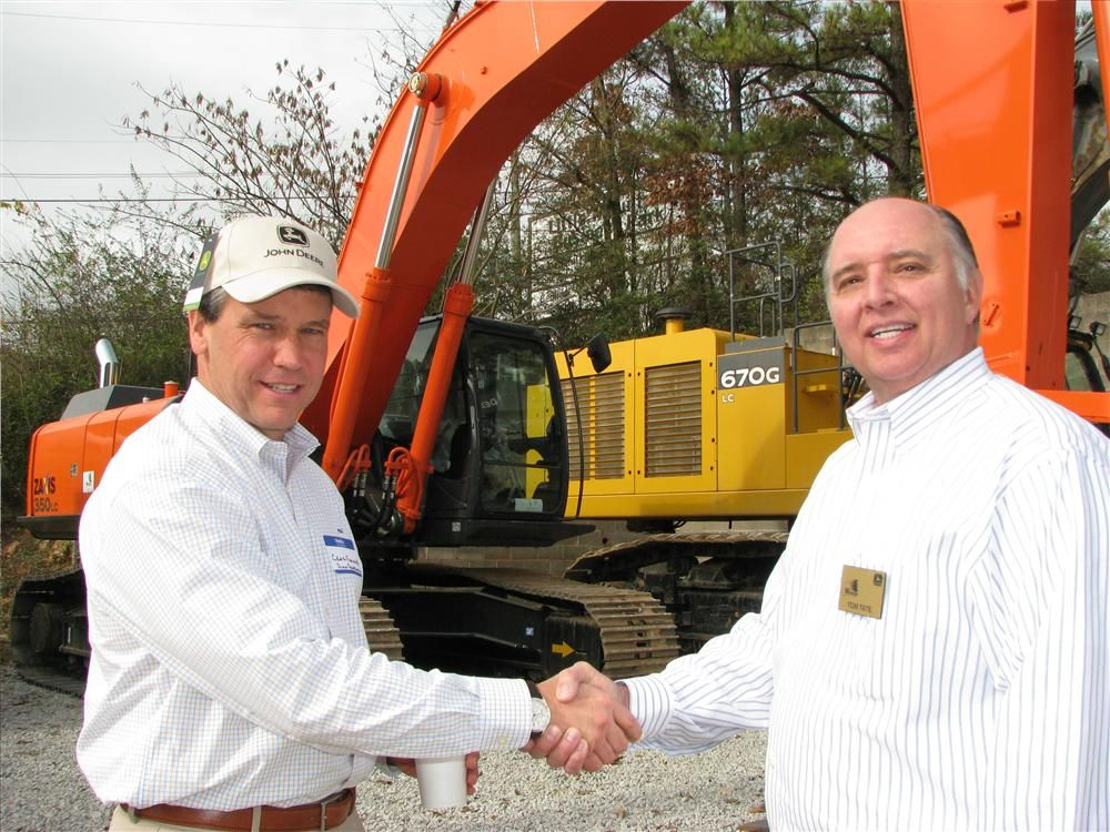 Craig Fleming (L), Dunn Construction, Birmingham, Ala., gets a warm welcome from Tom Tate, Warrior Tractor.
