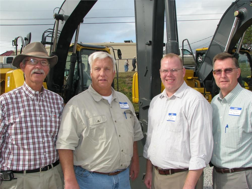 The many post-lunch chats between Warrior folks and their friends and customers included (L-R) Cleve Deason, Warrior Tractor; Lann Moore, Peter Lacy, and Rick Dees, H.N. Donahoo Contracting, Birmingham, Ala.