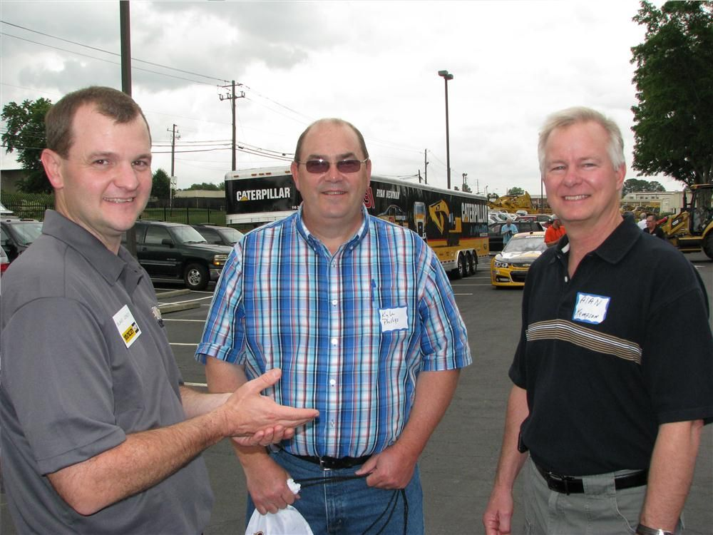 (L-R): Blake Jones, sales operations of Yancey Bros. Co., talks with customers Kyle Phillips and Alan Kempson of Southern Hydrovac, Powder Springs, Ga.