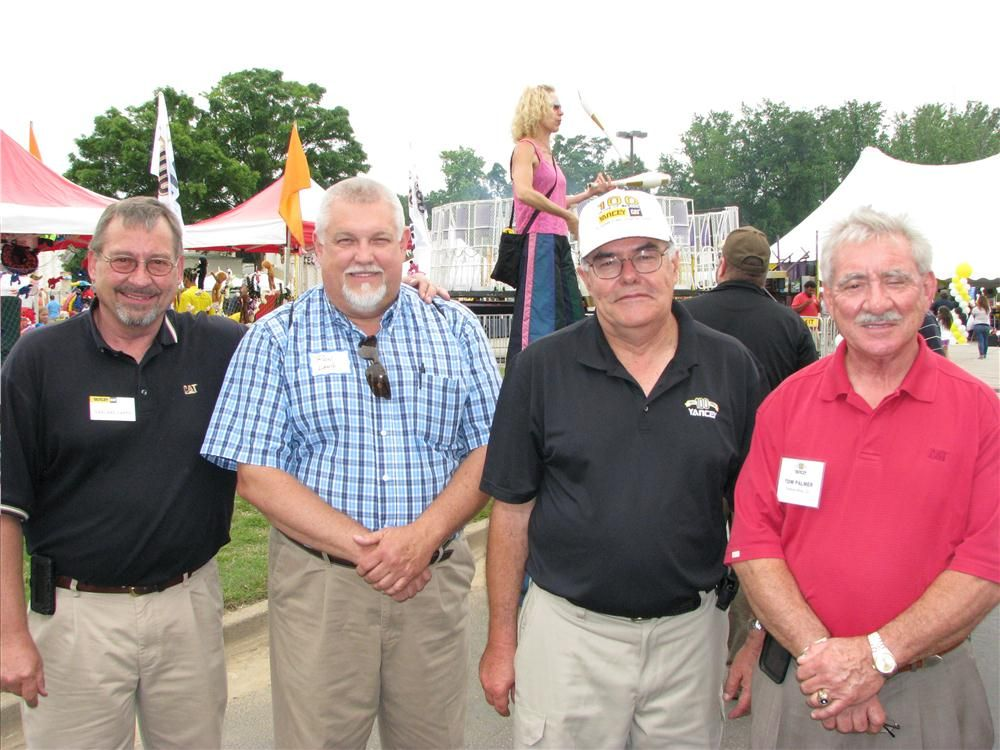 (L-R): Yancey's Garland Capps, Ron Lang, and Keith Thackston talk with Yancey retiree Tom Palmer, one of the many retired Yancey staffers in attendance at this event.