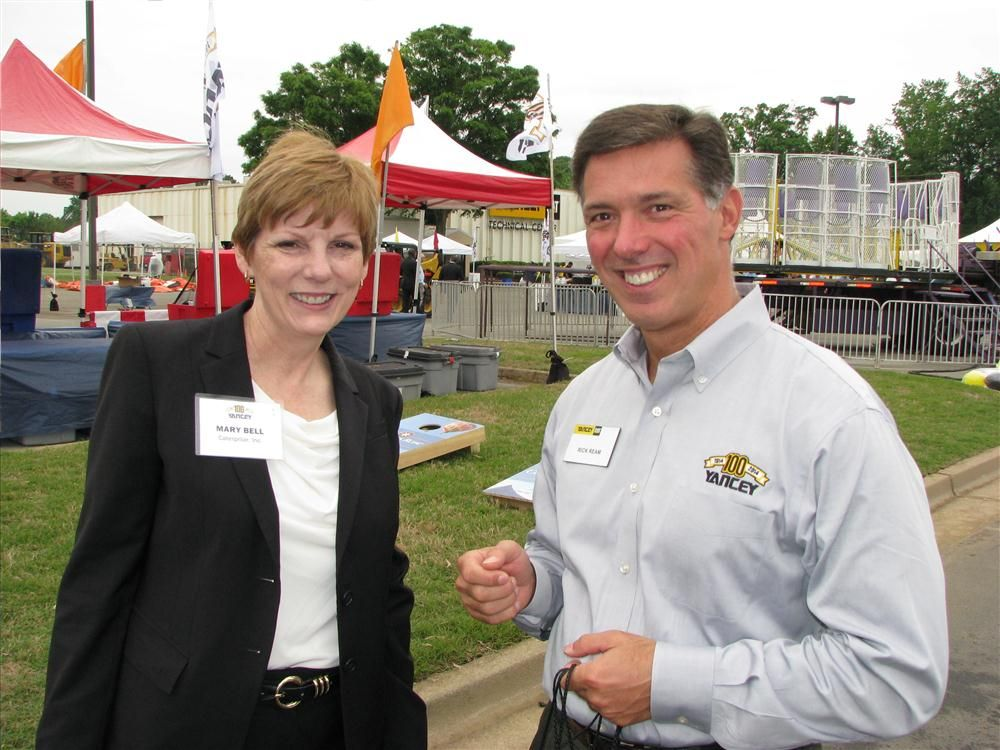 Mary Bell (L) began her Caterpillar career with Yancey Bros. Co. and worked her way up to become Caterpillar's vice president, building construction products division, and was back to celebrate the 100th anniversary with the folks from Yancey, inclu