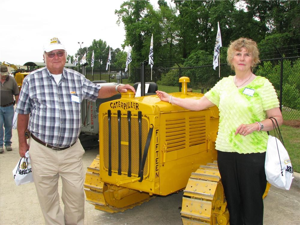 David Minshew, retired Master Technician and his wife, Carol, admire some of the antique tractors on display.