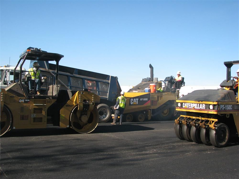 A new dual drum Cat CB54B and a pneumatic Cat PS-150C are used for rolling out the mat.