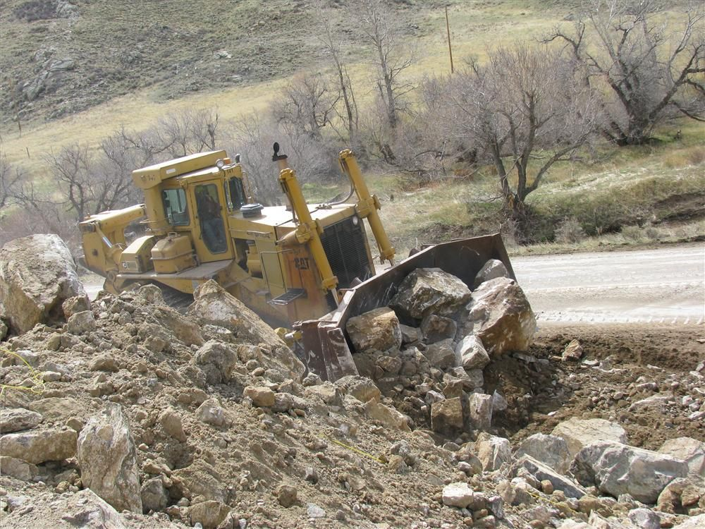 Oftedal Construction uses one of its Cat D9 dozers on a rock cut.
