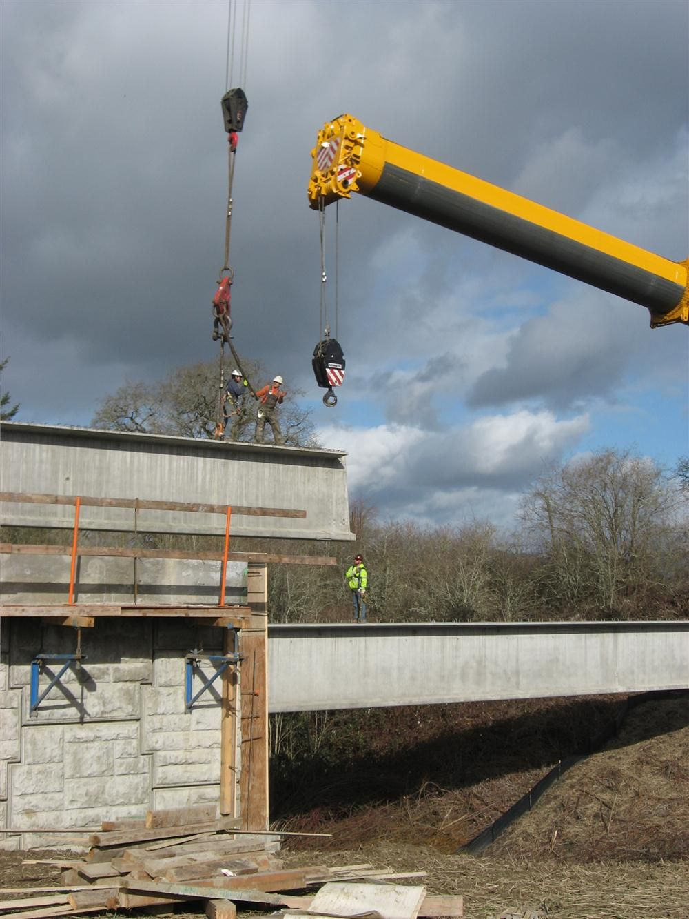 Contractors have already built one bridge, using large cranes to put the bridge beams in place.