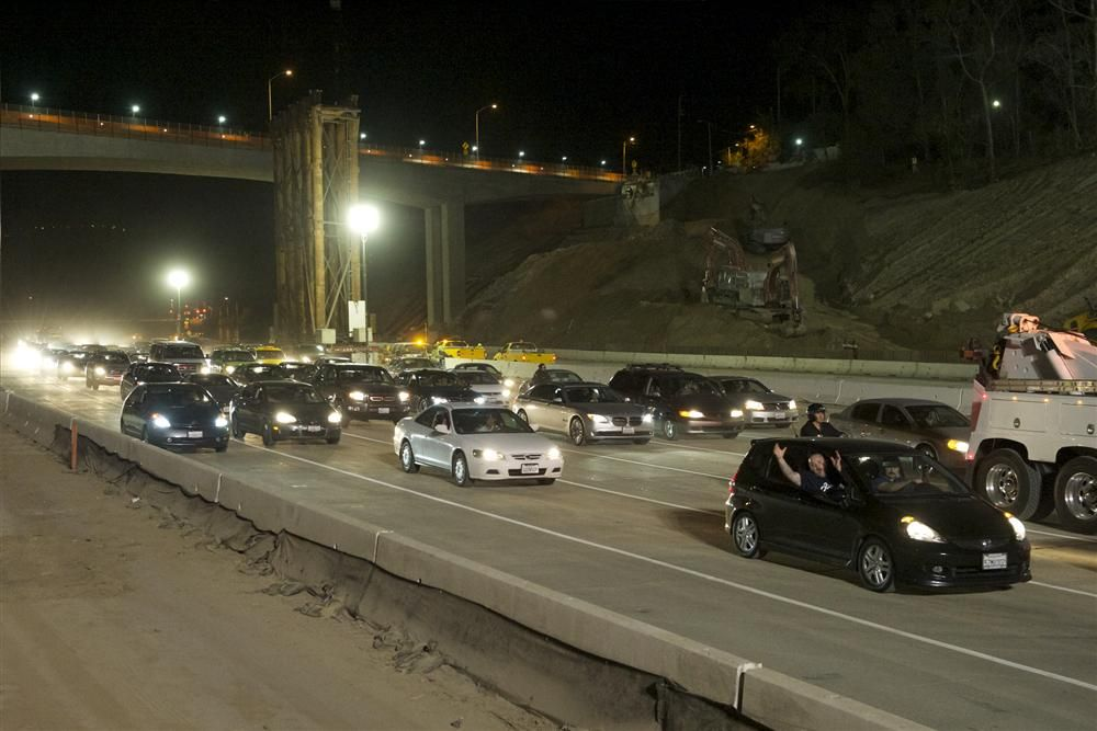 Motorists eagerly rejoin the freeway following the successful final demolition of the Mulholland Bridge.