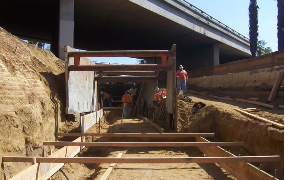 Crews prepare for retaining wall below the I-10 eastbound bridge over Sixth Street.