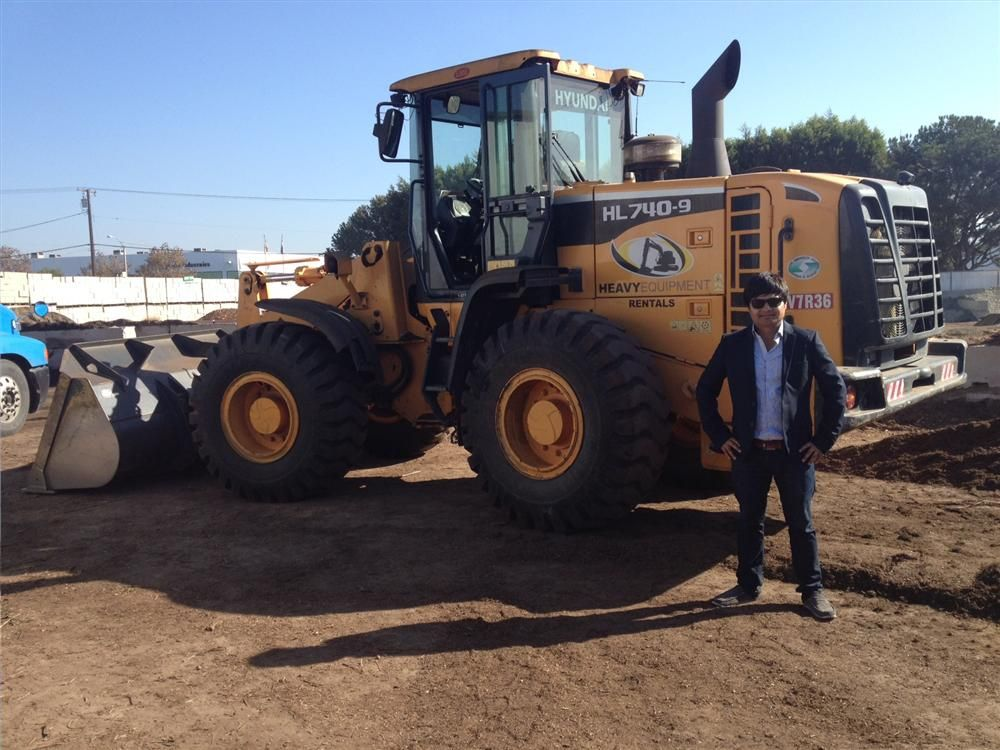 Gabriel Mejia, operations manager, with his Hyundai HL740-9 wheel loader.