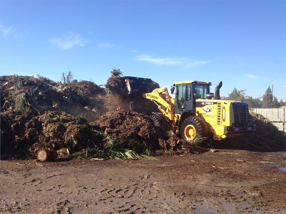 The HL740-9 loading green waste.