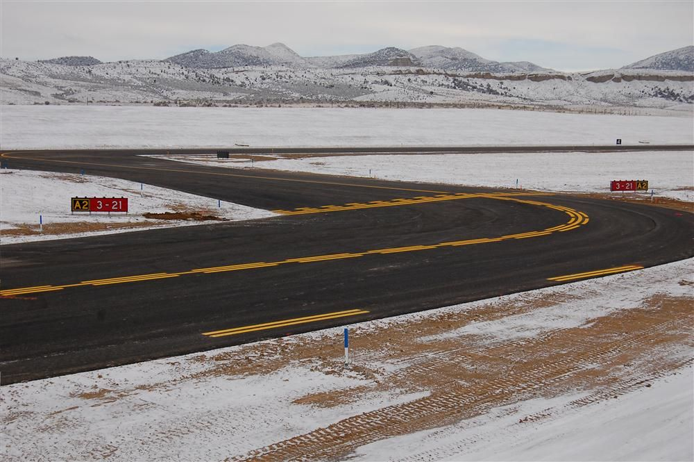 Construction consisted of the demolition of the existing 60-ft. (18 m) wide by 6,500-ft. (1,981 m) long runway and the construction of a new runway to meet C-II runway safety area and longitudinal standards.