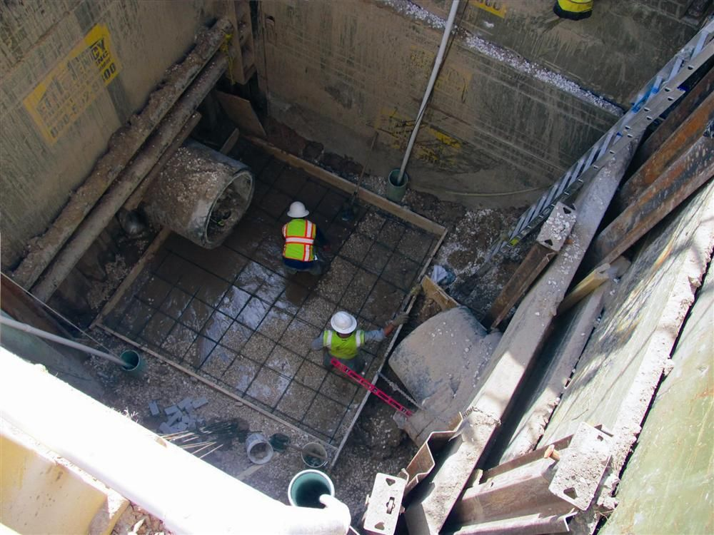 After employing additional well points, T-Con forms and pours the new manhole shield foundation.  They had just enough time to get it to cure before the ground water again began flowing into the excavation.