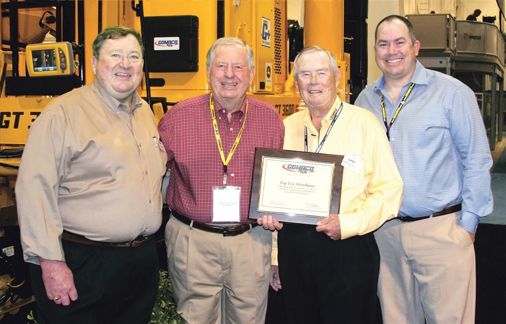 (L-R) are James Hayward, GOMACO United States and Canada western district sales manager; Terry Small, Terry Equipment Inc.; Gary Godbersen, GOMACO president and CEO; and Andru Small, Terry Equipment Inc.