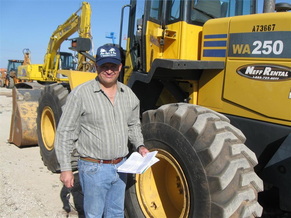 Carlos Toledo of M.I.S. Equipment in McAllen, Texas, is thinking he will bid on this Komatsu WA 250 loader.