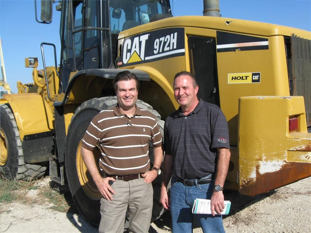 Gerald Jordan (L) and Harold Barney of Hurst Electric, Hurst, Texas, will probably bid on this Cat 972 H loader.