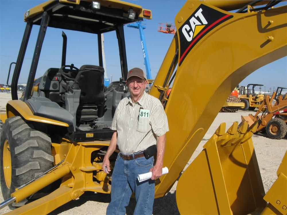 Bill Medlin, Medlin Electric in Quitman, Texas, is thinking he just might take this Cat 579 loader/backhoe home when he leaves.