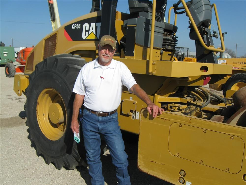 Cody Crabtree of Waddell Excavating in Fort Worth, Texas, is getting ready to check out this Cat CP56 pad-foot roller.