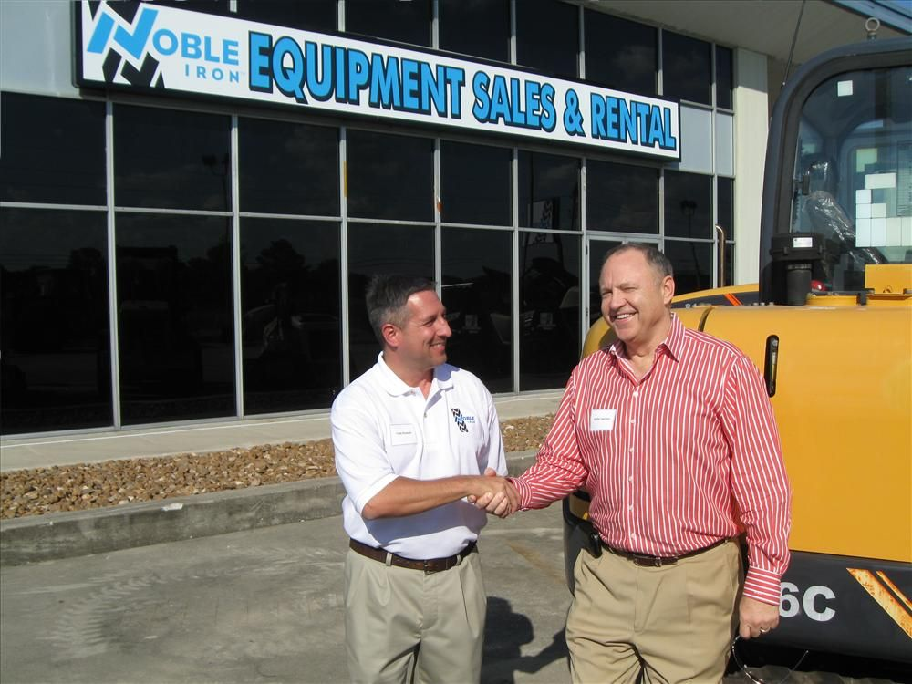 """General Manager, Tom Hlawek (Left),  gets an """"AttaBoy"""" from Founder, President and CEO of Noble Iron, Willie Swisher."""