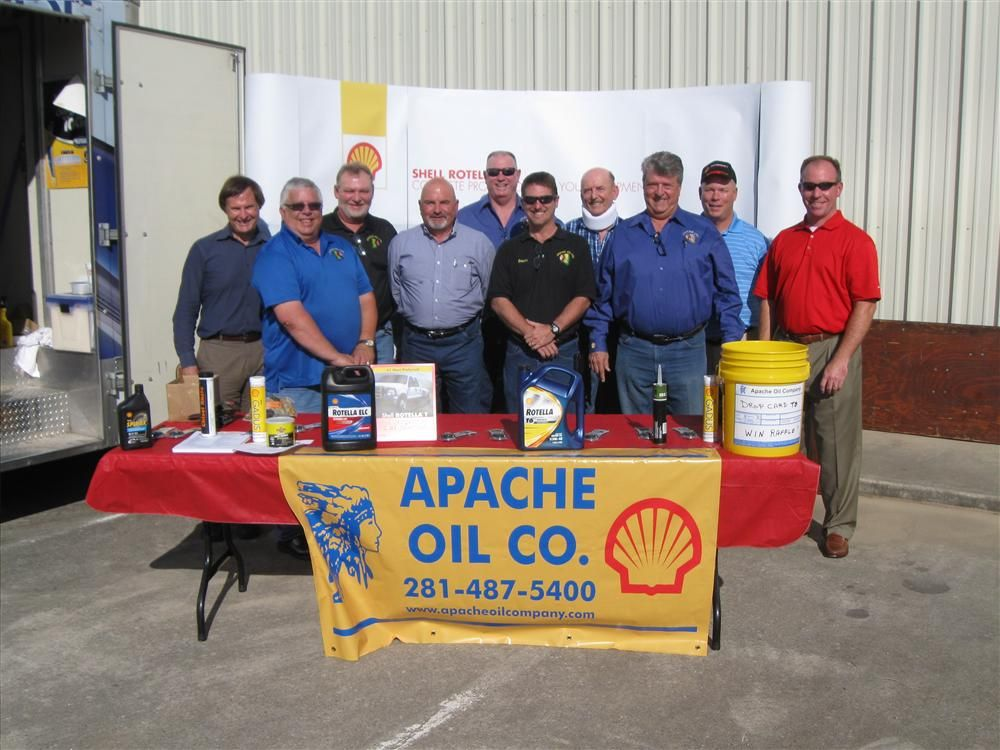 From Left to Right:  Bill Records,  Eddie Miller, Mike Toombs, Jay Britt, David Kirkpatrick,  David Albright, Tim Smith and Dick Schock all with Apache Oil Co in Pasadena, Texas pose with,  Gib Wheatley and Jarrett Enochs with Shell Oil.