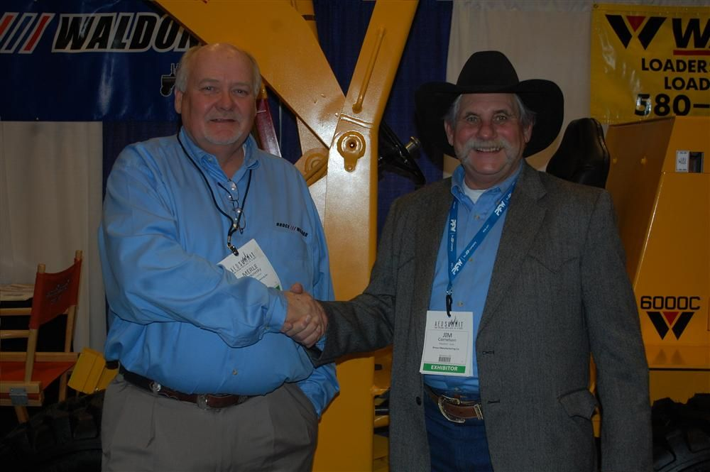 Merle Patzkowsky (L), managing partner, Waldon Equipment shakes hands with Jim Cornelson, president, sales, Broce/Waldon, recently during the AED Summit Condex show in Las Vegas.