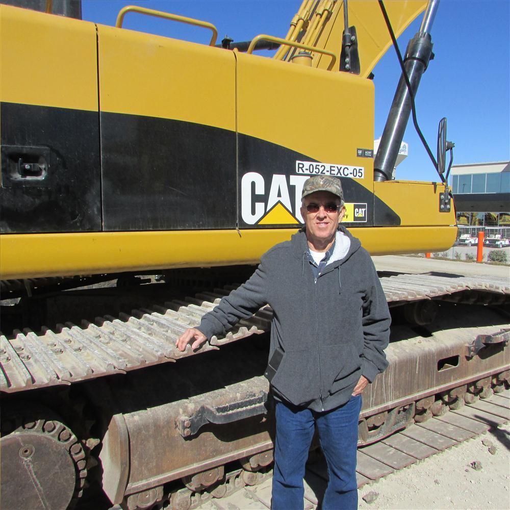 Marvis Braswell of Trak Traders in Cleburne, Texas, has just given this Cat 345D excavator a careful check-out.