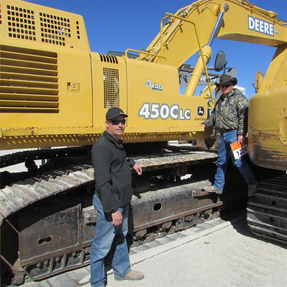 Dusty (L) and Andy Quinn, independent site prep contractors in DeLeon, Texas, think this John Deere 450C LC excavator might be just what they have been looking for.