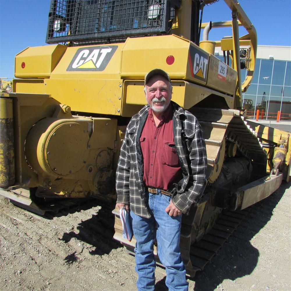 John Williams, Williams Truck and Tractor Service in Palmer, Texas, takes a pose with a Cat D6T XW.
