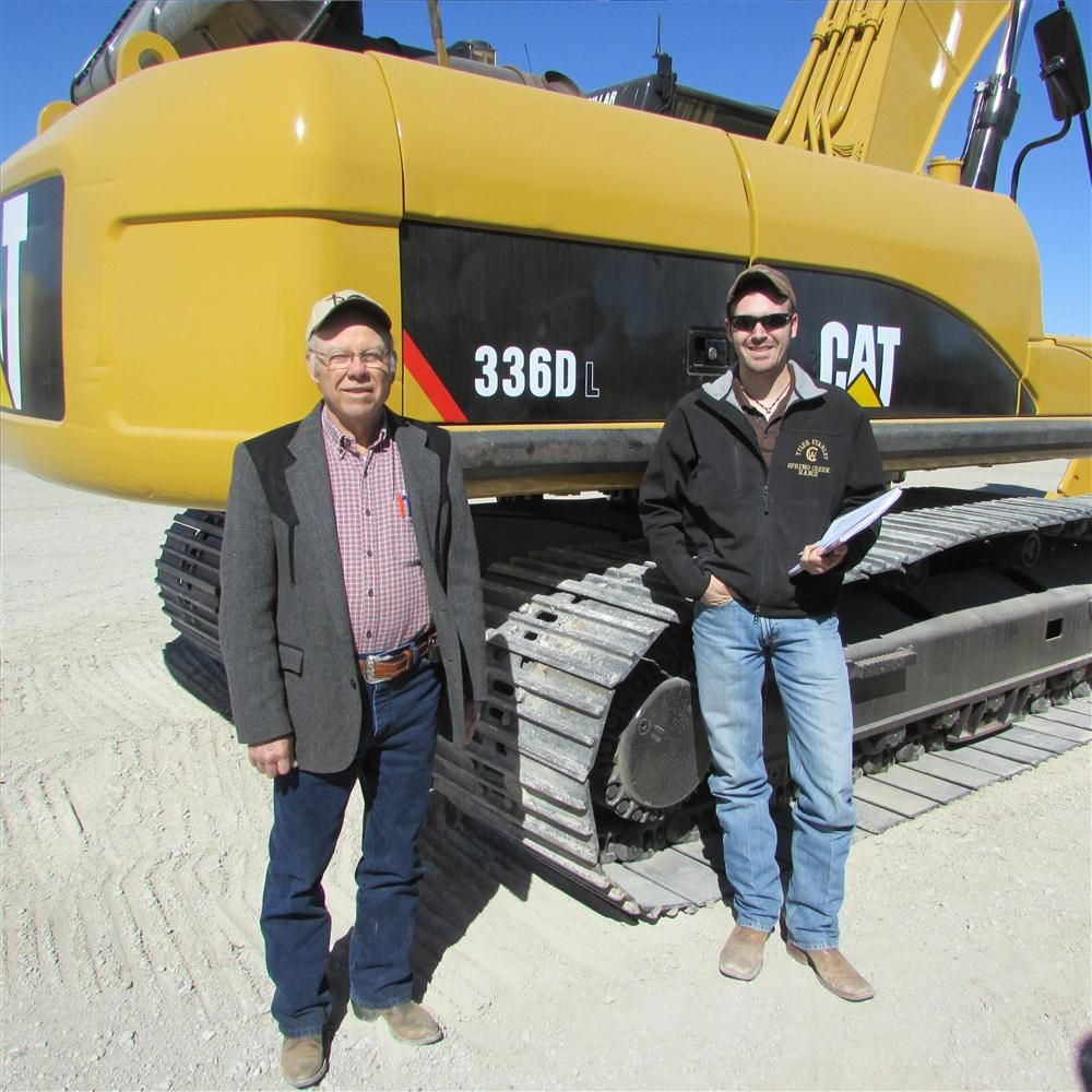 Clovis Alexander (L) and grandson, Tyler Stanley, of Select Fill in Bonham, Texas, are going to bid on this Cat 336D L excavator.