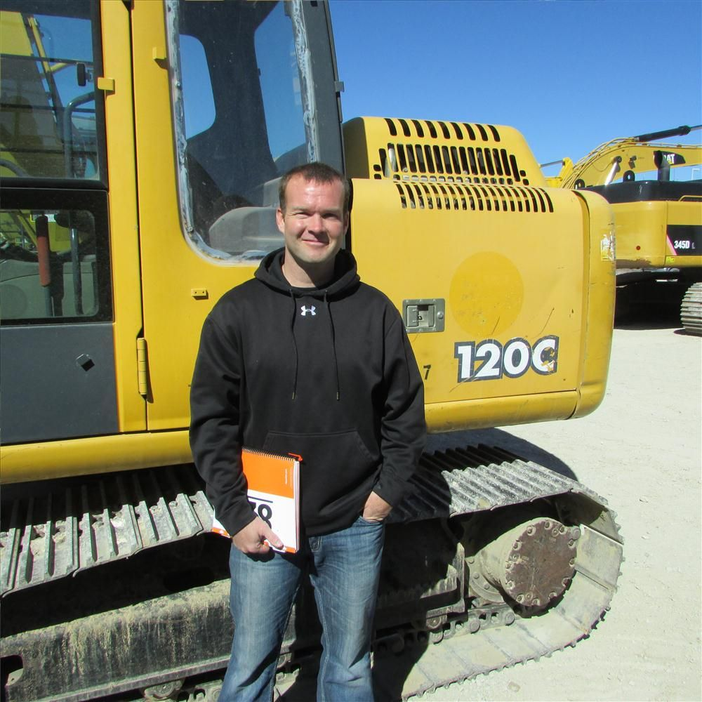Greg Braswell, Trak Traders in Cleburne, Texas, thinks this John Deere 120C may go home with him.