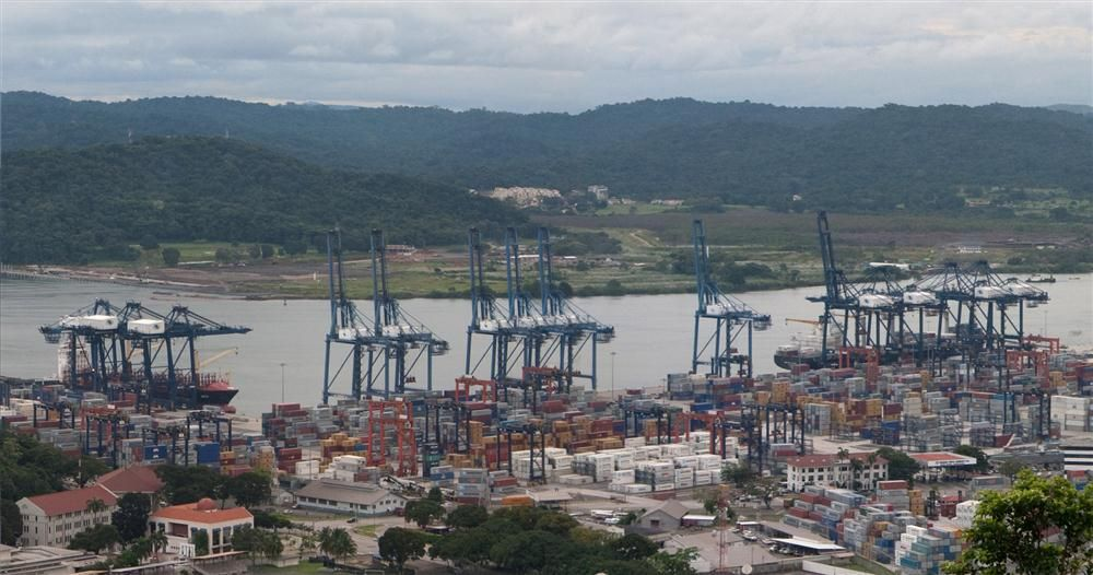 Photo courtesy of Brian Gratwicke. The construction of the 48-mi. (77 km) ship canal across the Isthmus of Panama a century ago transformed international trade.