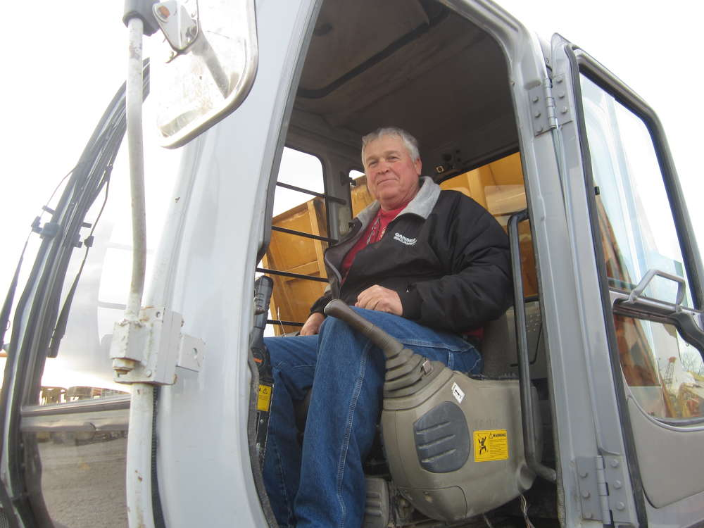 Rich Gansen of Gansen Excavating checks out the controls of this Morooka MST-2200VD.