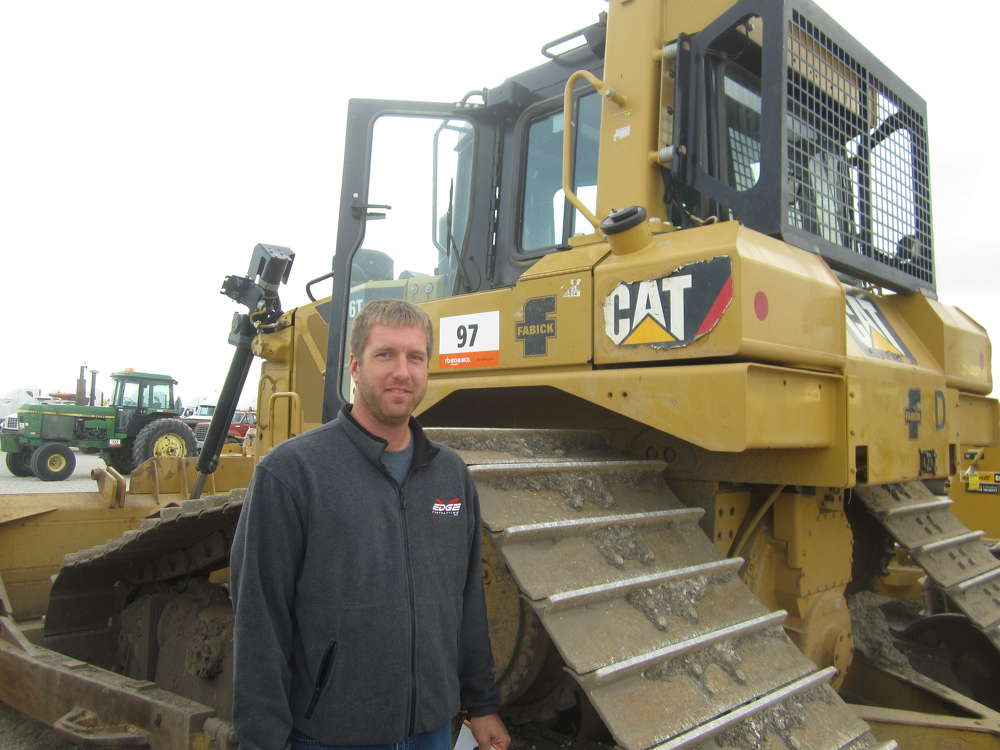 Jerry Brehm of Edge Contracting Inc. completes an inspection of this Cat D6T before bidding on the machine.