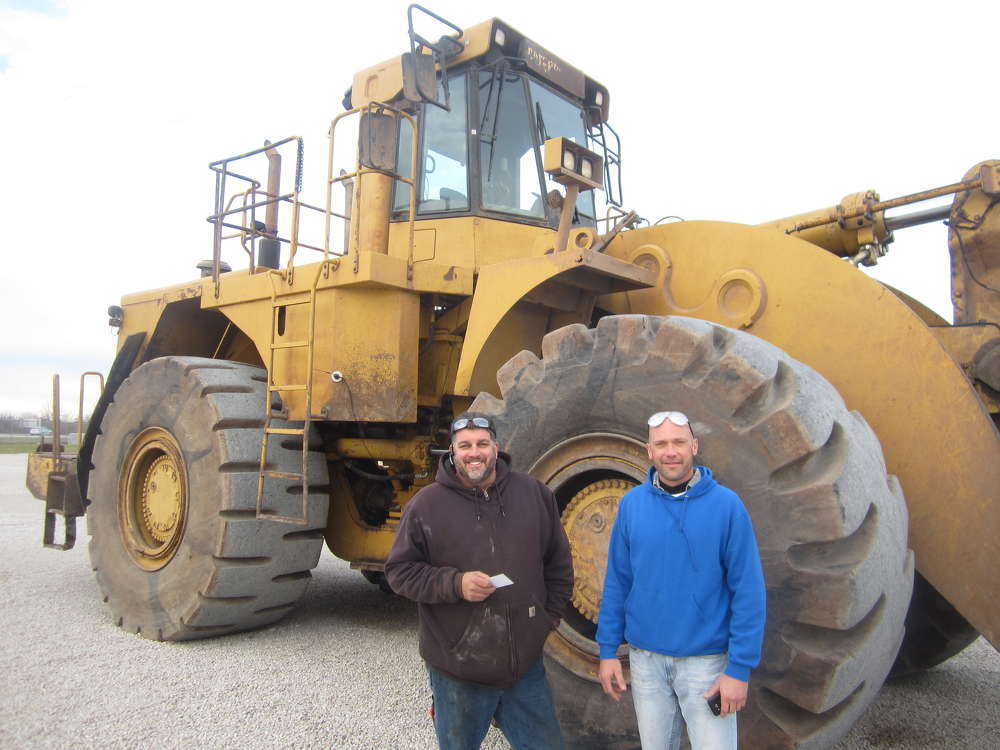 John Stevens (L) and Chris Johnson, both of Franks Excavating, inspect this Cat 990 wheel loader.